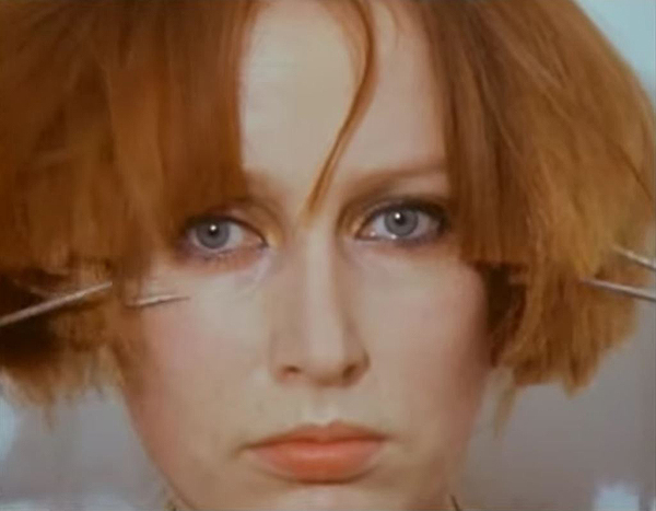 Screen shot from Rebecca Horn's Cutting Hair and Oasis movie from 1974-75