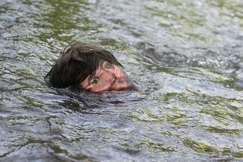 This is a picture of a mankin face in a moving stream of water by Richard Haley